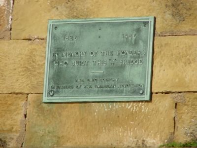 Plaque on West-Facing Arch image. Click for full size.