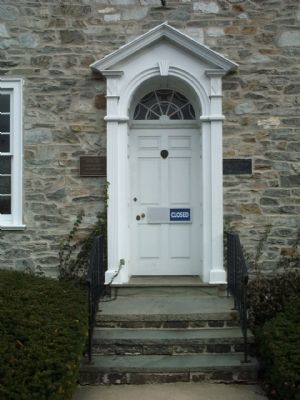 Old Masonic Lodge front entrance, showing the markers on each side of the door. Photo, Click for full size