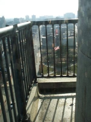 Looking through the railing at the top of the monument. image. Click for full size.