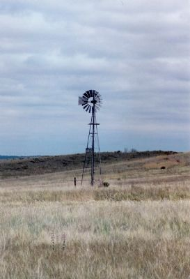 One of Many Windmill Water Pumps That Dot the Landscape thru This Region image. Click for full size.