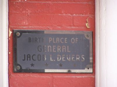 Marker on porch of house. image. Click for full size.