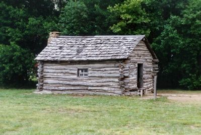 Replica of Ingall's 1870 cabin at the original site image. Click for full size.