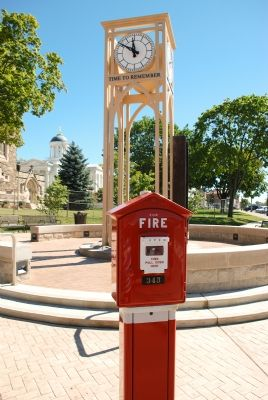 Traditional fire alarm box incorporated into memorial image. Click for full size.