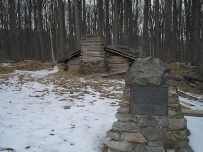 Marker with Hut in background image. Click for full size.