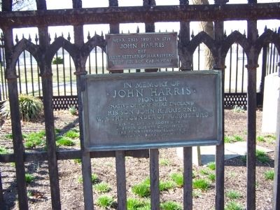 Plaques on burial plot fence image. Click for full size.