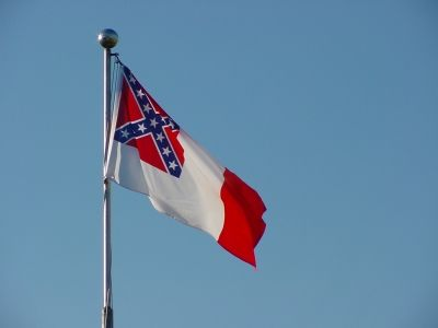 The Third and final Confederate National Flag waves over the dead