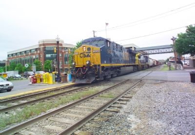 Eastbound Freight Passes the Station image. Click for full size.