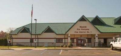 Marker is to the left of the Wayside Fire Company entrance image. Click for full size.