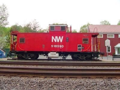 NW Caboose 518590 and Marker at the Caboose Plaza image. Click for full size.