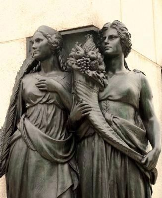 "Two of the four allegorical female figures, ""Peace"" and ""Plenty."" image. Click for full size."