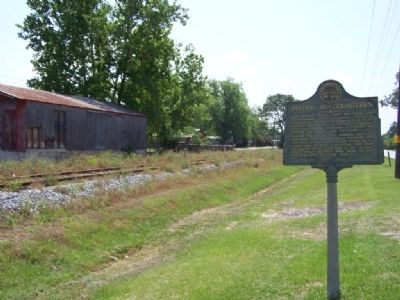 Marker alongside one-time Railroad siding image. Click for full size.