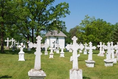 Gravestones in cemetery and church image. Click for full size.