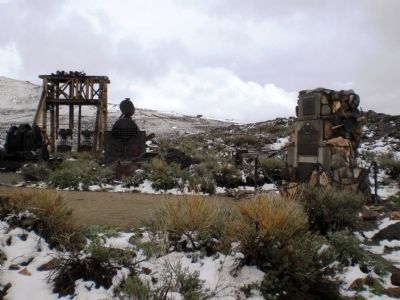 Bodie Monument, wide shot showing monument and former mining equipment image. Click for full size.