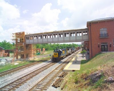Pedestrian Bridge Connects Station to Shops Photo, Click for full size
