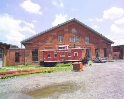 B&O Wooden Caboose No. C1913 and Shop Building image. Click for full size.
