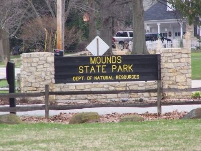 The wooden sign at the front of Mounds State Park. Photo, Click for full size