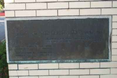 Corner plaque on Queen of the Rosary School. image. Click for full size.