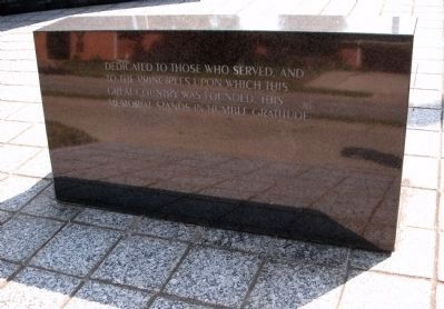 Back of Dedication Stone Bench at Memorial Entrance image. Click for full size.
