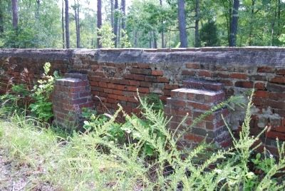 Newer brick columns hold up the sagging wall image. Click for full size.