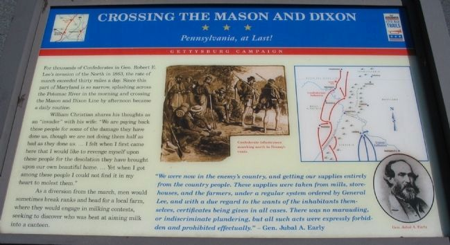 Crossing the Mason and Dixon Marker image. Click for full size.