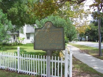 Old Spanish Garden Marker, amoung houses, with Ocean Blvd in background image. Click for full size.