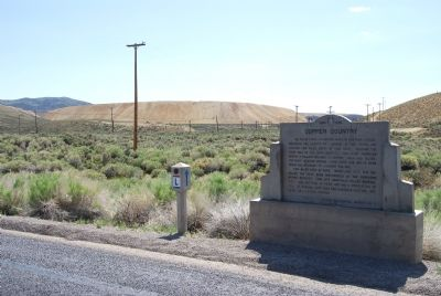 Marker and waste rock piles in the distance image. Click for full size.