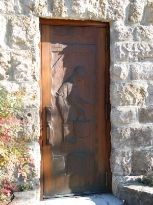 Carved Wooden Door at Side Entrance to Winery Building image. Click for full size.