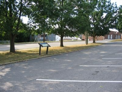 The Marker Stands beside the Road in the Curch Parking Lot image. Click for full size.