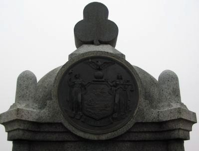 State Seal and Trefoil on Top of Monument image. Click for full size.