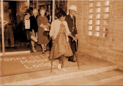 Mrs. Georgie Mae Reed leaving the Ponce de Leon Motor Lodge Photo, Click for full size