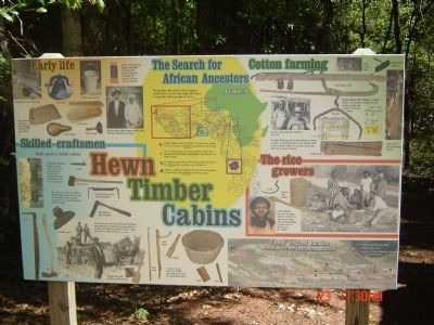 Hewn-Timber Cabins Information Sign image. Click for full size.