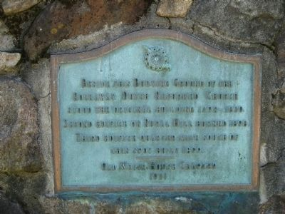 Marker on exterior wall of cemetery image. Click for full size.