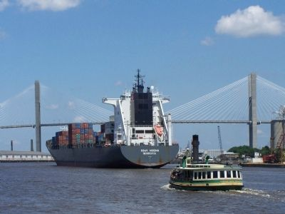 Shipping in the Port of Savannah , Ferry boat works the river along with a container ship image. Click for full size.