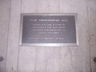 Plaque on opposite side of the wall from the 9XM-WHA marker image. Click for full size.