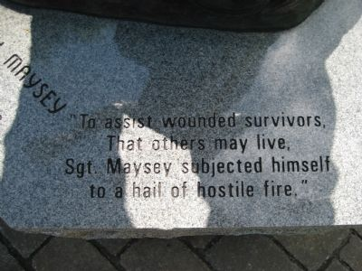 Inscription at base of statue image. Click for full size.