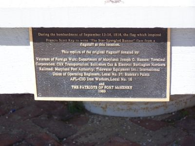 Plaque at base of flagstaff image. Click for full size.