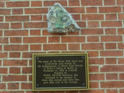 Berlin Wall relic mounted on side of Zion Church image. Click for full size.