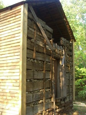 John W. Hall's log cabin, undergoing renovation. image. Click for full size.