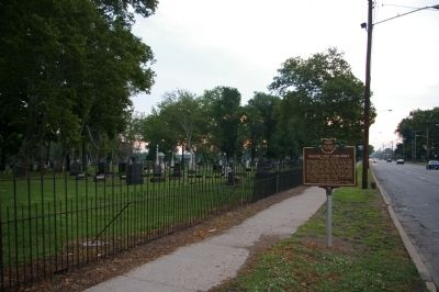Marker, in front of Woodland Cemetery image. Click for full size.