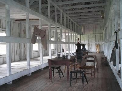 Inside Confederate Prison Barracks image. Click for full size.