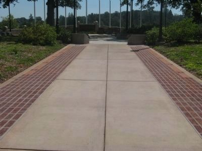 Veteran & Memorial Pavers Line Both Sides of Walkway to Monument image. Click for full size.