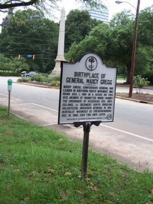 Gregg Marker, seen along Senate St. 1/2 block from State Capitol seen in distant background image. Click for full size.