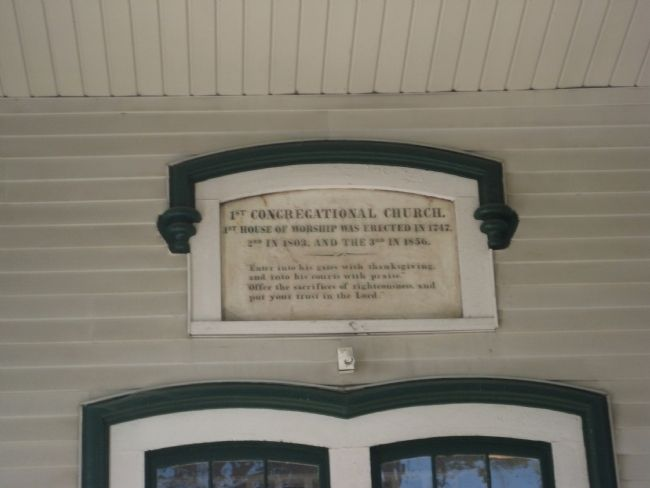 Plaque above main entrance image. Click for full size.