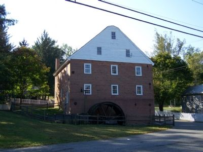 East side of mill with water wheel. image. Click for full size.