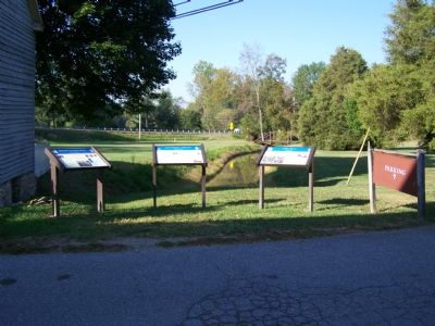 View of three Civil War Markers along Mill Race to Big Pipe Creek. image. Click for full size.