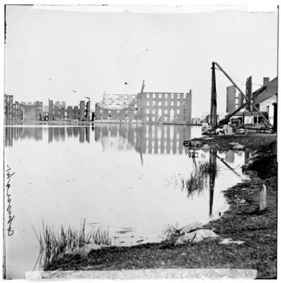 Richmond, Va. Ruined buildings on banks of the Canal Basin. image. Click for full size.