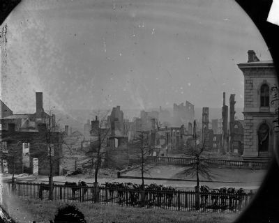 Burnt district (horses hitched to iron fence on foreground) image. Click for full size.