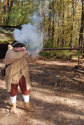 Reenactor firing the musket. image. Click for full size.