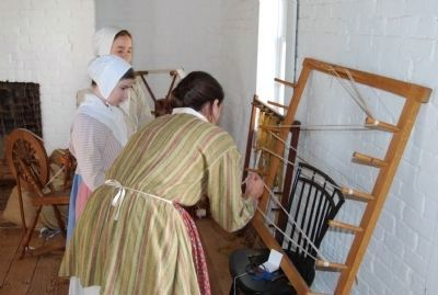 Reenactor working with yarn image. Click for full size.