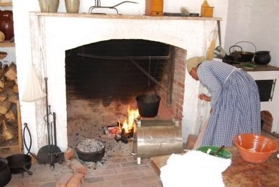 Reenactor cooking in the kitchen image. Click for full size.
